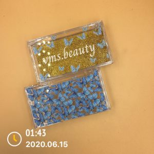 clear eyelash packaging with blue butterfly